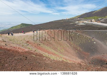 MOUNT ETNA ITALY - MAY 23: Tourists walking around Silvestri crater at the slopes of Mount Etna on May 23 2016 at the island Sicily Italy