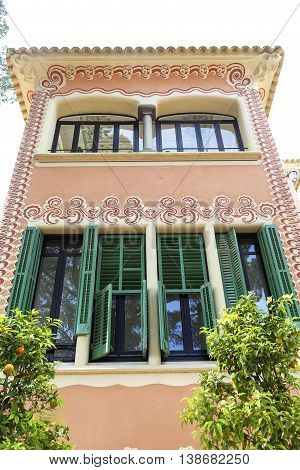 BARCELONA SPAIN - MAY 13 2016 : Decorative facade on Gaudi House Museum. Building located near the Park Guell in Barcelona was the residence of Antoni Gaudi for almost 20 years from 1906 to 1925.