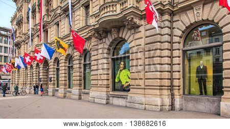 Zurich, Switzerland - 1 August, 2014: facade of the Credit Suisse building on Paradeplatz square decorated with flags. Credit Suisse Group is a Swiss multinational financial services holding company headquartered in Zurich.