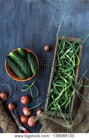 Fresh Garlic Scapes, Potatoes And Cucumbers, Top View