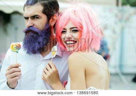 Glamour Couple Eating Lollipop