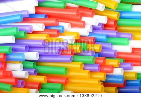 Colorful plastic drinking straws close up as background