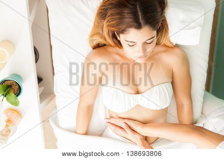 Top View Of Woman Getting A Belly Massage