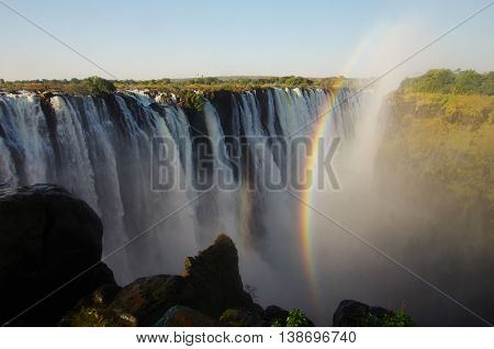 Powerful Victoria falls with rainbow, seen from Zimbabwe side