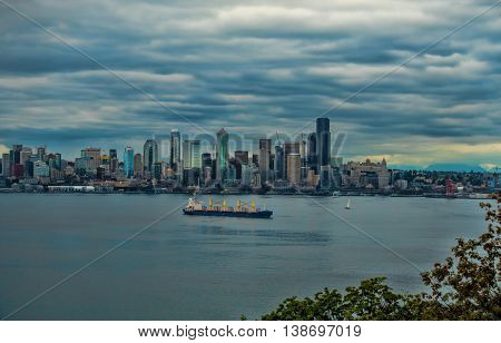 Storm clouds hover over the Seattle skyline.
