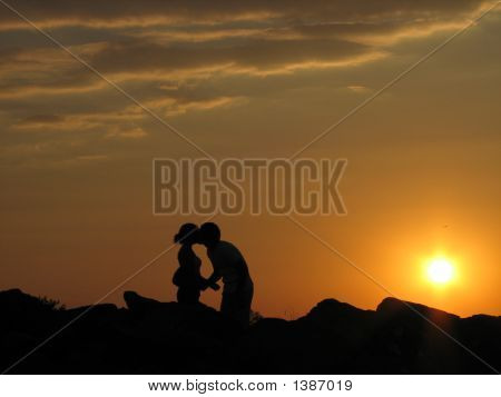 1a couple kissing in a sunset. Love and