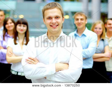 Young business executive - Mature business man with his colleagues in the background