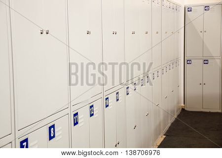 Student Gym Lockers University School Campus Hallway Storage Locker College. Locker Room. Lockers cabinets in a locker room at school or museum or station. Interior is modern locker rooms in Gym