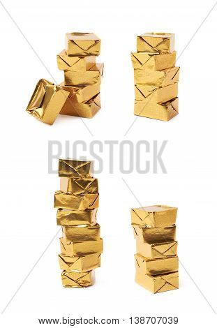 Stack of mulitple bouillon stock broth cubes wrapped in golden foil, composition isolated over the white background, set of four different foreshortenings