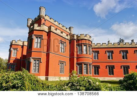 Romantic castle with red facade. Hradek u Nechanic. Czech Republic. Nechanice. July 7, 2016