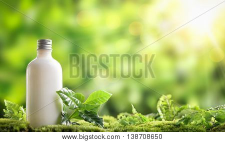 cosmetic bottle on nature background