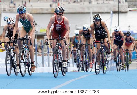 STOCKHOLM - JUL 02 2016: Large group of female triathlete cyclists cycling uphill in the Women's ITU World Triathlon series event July 02 2016 in Stockholm Sweden