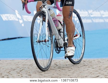 STOCKHOLM - JUL 02 2016: Closeup of a triathlete cycle on cobblestone in the Women's ITU World Triathlon series event July 02 2016 in Stockholm Sweden