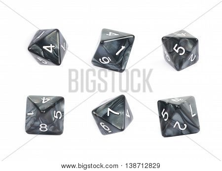 Roleplaying black polyhedral octahedron gaming plastic dice isolated over the white background, set of six different foreshortenings