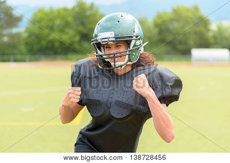 Motivated Young Woman Playing American Football