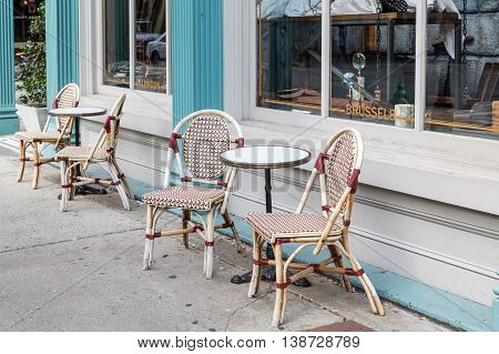 Chairs and Round Tables on Sidewalk outside cafe