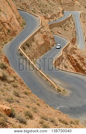 DADES GORGES, MOROCCO - JULY 11: Overloaded car on a winding road, July 11, 2013 in Dades Gorges, Morocco. Road in Dades Gorges very popular tourist route in east Morocco.