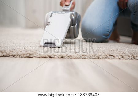 Image of modern house cleaning by cordless handheld vacuum cleaner