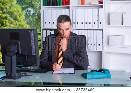 Business Man At His Desk Is Amazed