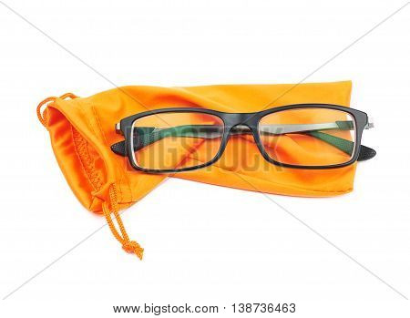 Pair of glasses and protective orange pouch bag with the drawstrings, composition isolated over the white background