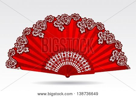 Open vintage folding red fan with a lace ornament isolated on white. Contains the Clipping Path