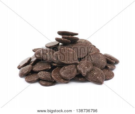 Pile of cooking chocolate teardrop shaped chips isolated over the white background