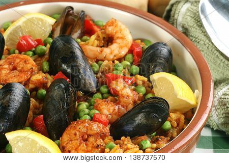 paella close up with mussels and king prawns