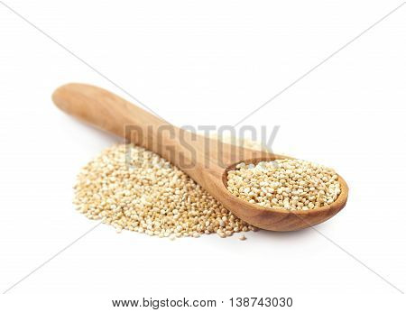 Pile of grain quinoa seeds isolated over the white background