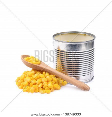 Tincan with a pile of canned corn and a wooden spoon next to it, composition isolated over the white background