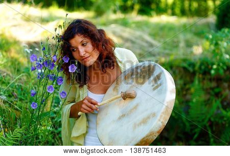 Beautiful Shamanic Girl With Shaman Frame Drum On Background With Leaves And Flowers.