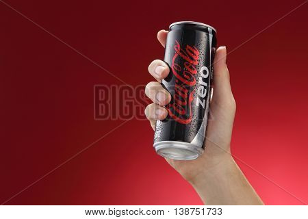 Kuala Lumpur,Malaysia 11th July 2016, Hand hold a  can Coca-Cola Zero on red  background. Coca Cola drinks are produced and manufactured by The Coca-Cola Company.