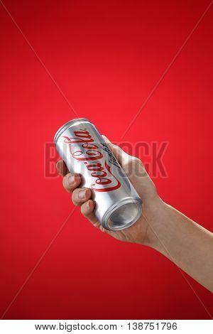 Kuala Lumpur,Malaysia 11th July 2016, Hand hold a can Coca-Cola light on white background. Coca Cola drinks are produced and manufactured by The Coca-Cola Company.