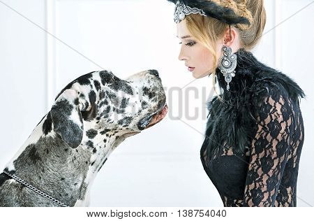 Portrait of a fashionable woman and big dog