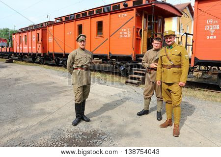 DOBRANY CZECH REPUBLIC - JUNE 17, 2016: Unidentified soldiers in historic Czech legionary uniforms as a guard of military armoured train. Historical reenactment. Reconstruction of russian civil war.