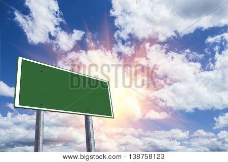 Blank Freeway Sign Against A Blue Sky.