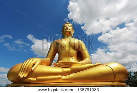 big gautama buddha with  bule sky and cloud background