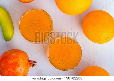 Glass of orange and basil seeds drink.