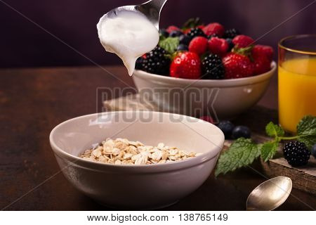 Flavoring Oatmeal With White Yoghurt And Some Berries