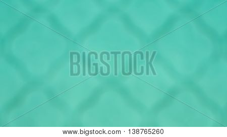 Blurred unfocused dark grid on bright turquoise background. Abstract turquoise colored gradient art geometric background