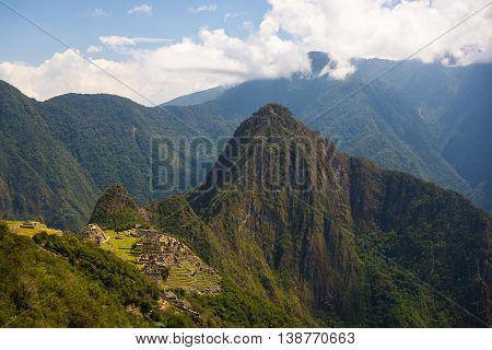 Machu Picchu Archeological Site And Wayna Picchu Illuminated By The Sunlight.
