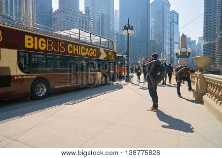 CHICAGO, IL - CIRCA MARCH, 2016:  double decker bus at Chicago downtown in the daytime. Chicago is the third most populous city in the United States.