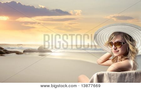 Beautiful woman in swimsuit at the seaside
