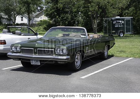 Spring Lake NJ USA July 11 2015 Classic Oldsmobile on display at an antique car show in Spring Lake NJ