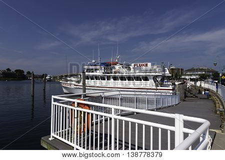 Belmar NJ USA June 26 2014 Fishing boats docked in the Belmar Marina as they wait before heading out to sea.