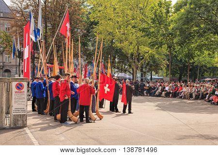 Zurich, Switzerland - 1 August, 2014: people on Burkliplatz square listening to the speech devoted to the Swiss National Day. The Swiss National Day is the national holiday of Switzerland celebrated on the 1st August.