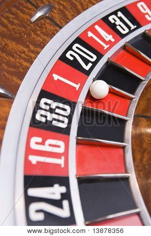 Close up of ball on roulette wheel with ball in number one slot