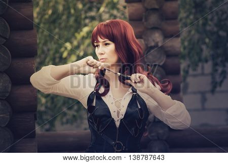woman with red long hair robber lives in the forest