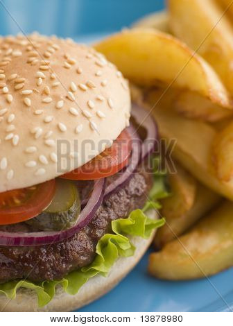Beefburger with Salad and Pickles in a Sesame Seed Bun with Chips