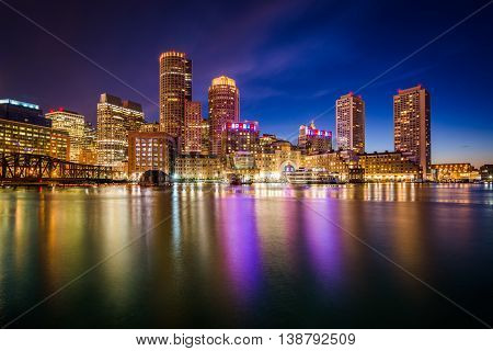 The Downtown Skyline At Night, Seen From Fort Point In Boston, Massachusetts.