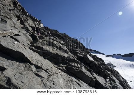 alpinists climbing on monte rosa in italy